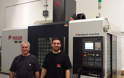 Bruce and Bradd Sarro stand by the Feeler VMP-1100S VMC