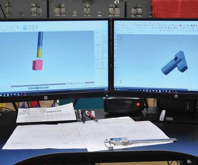 CAM software on two computer monitors