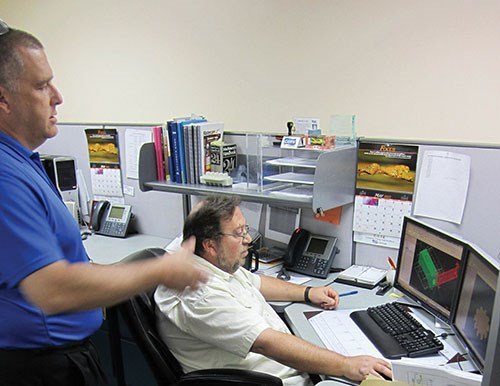 Jim Eilandfrom Cope Plastics consults with Mark Clark of Mastercam reseller QTE Manufacturing Solutions