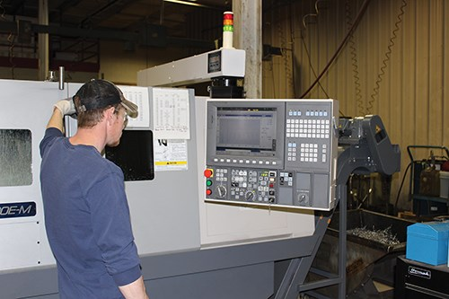 an operator monitors spindle load
