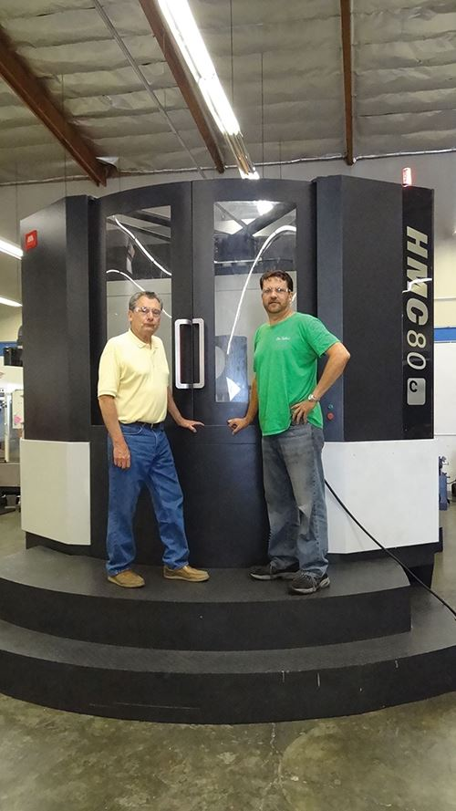 Larry and Rodney de Caussin with the SMTCL HMC80 machining center