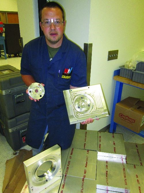 Machinist Randy Kral shows components