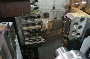 Swiss-style lathe with a subspindle