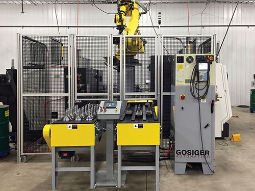 robot lifts parts from conveyor