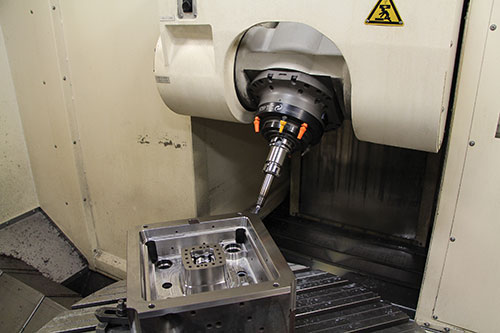 moldmaker with five-axis positioning