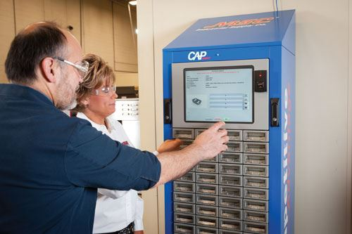 Employees retrieve tools from the single-bay CAP dispenser from MSC.