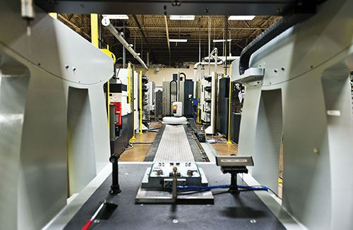 Brown & Sharpe One CMM looks over 3R Workmaster Linear automation solution