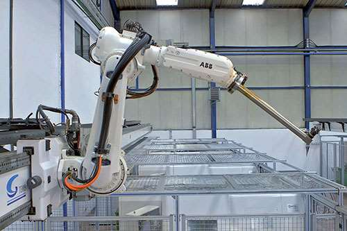 The top-mounted, linear-axis ABB 6620LX robot serves four CNC machining centers