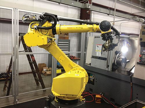 The FANUC robot uses two, three-jaw gripper units to load and unload two parts at a time.