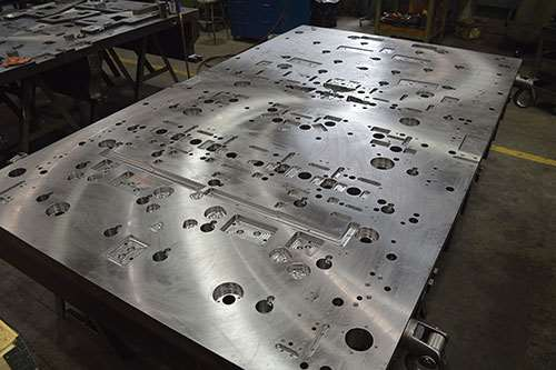 This lower die plate is made of hot rolled steel and measures 3.5 by 72.0 by 120.0 inches.