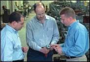 Mark Lawrence of C.J. Winter Machine Technologies, Rick Vice of Cam-Tech Inc. and Paul Allart of C.J.