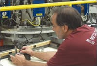 Mr. Martinez checks the parts