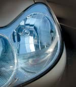 Multi-faceted surface of a headlamp reflector