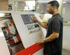Operator And CNC Lathe