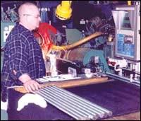 Operator Mike Rushnok monitors steering rack blanks
