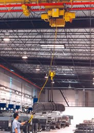 Overhead cranes and storage racks with roll-out shelves