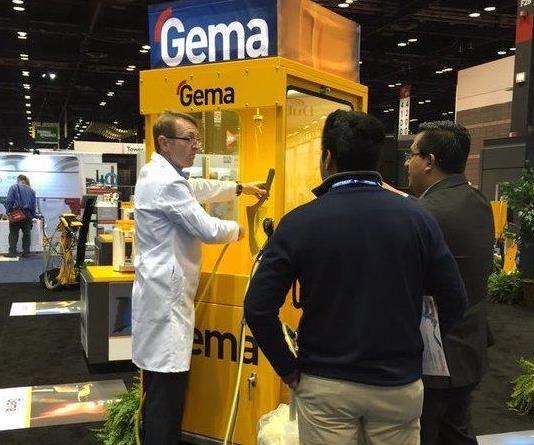 Jeff Hale instructs visitors about Gema products at a recent trade show.