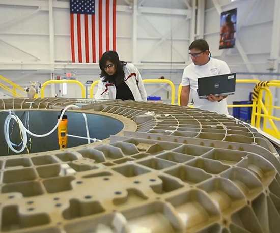 Boeing employees working on the CST