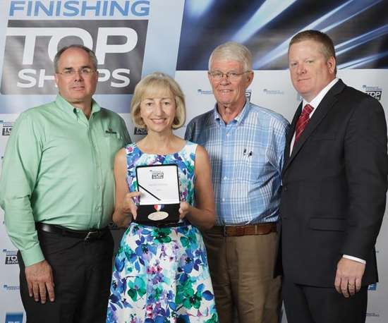 4 people holding award