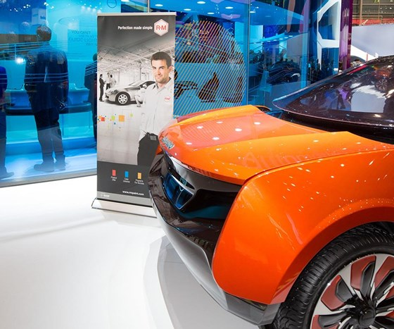 The Covestro display featuring the concept car with BASF's R-M Onyx HD waterborne paint.