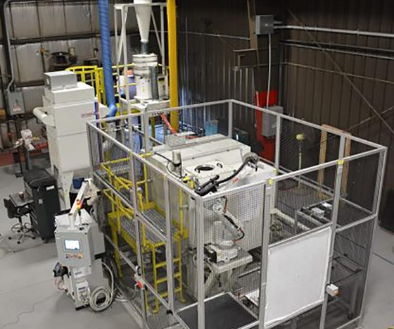 Dual robotic cell for grit blast finishing from Guyson.