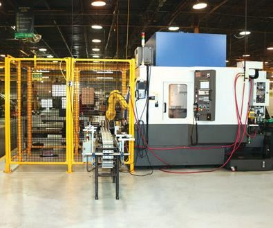 Automated cell comprised of a Tongtai machining center with rotary pallet changer, a FANUC robot and a conveyer system