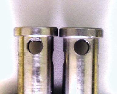 Check valves, with a burr (left) and without.