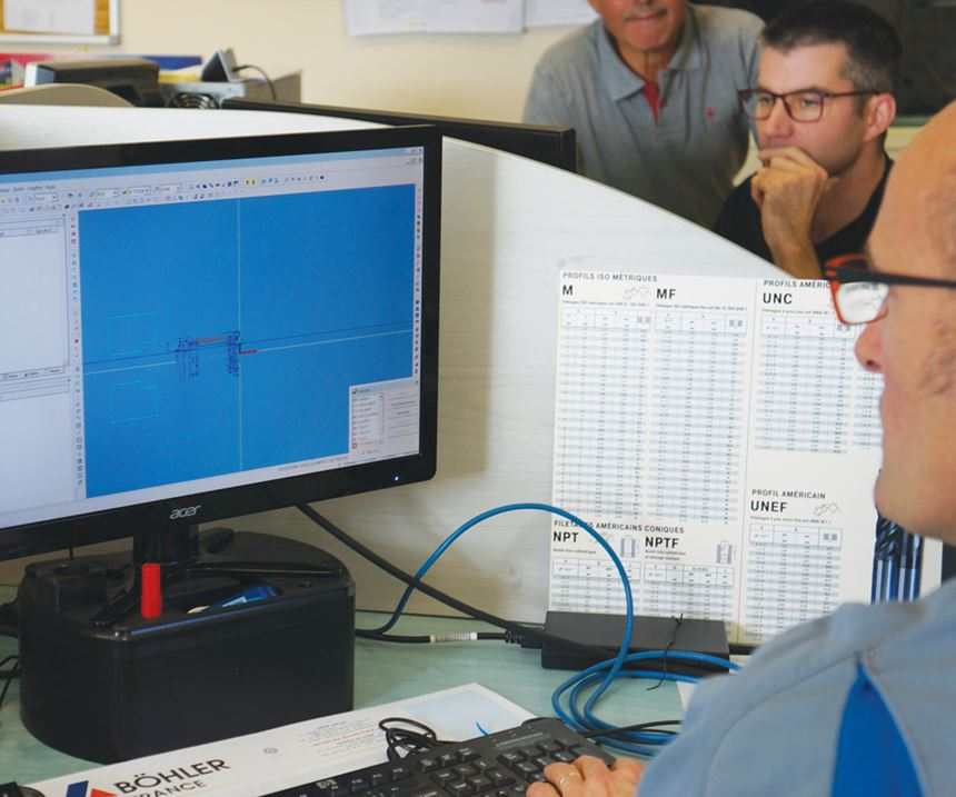 Man at computer generates five-axis and 3D milling programs with the company's new software