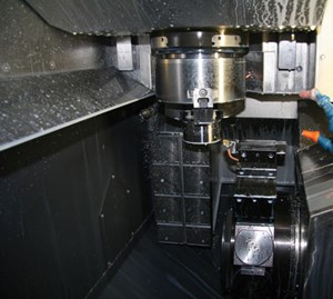 This EMCO vertical turning center provides quick loading through the spindle's direct pick up of the raw material.