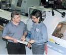 Precision-Tek president Keith Pflum and operator Sean Mitchell