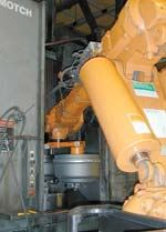 Robot loads machines