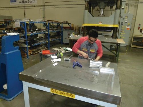 Jose Roque, a hydraulic press operator