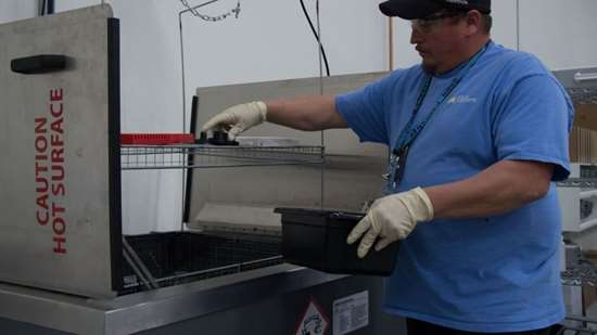 Removing cleaned parts from ultrasonic cleaner