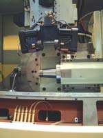 The autoloader serving the grinding machine