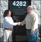 Tim LaSpina, president of LaSpina Tool & Die, and ERP vendor, Billie Henning