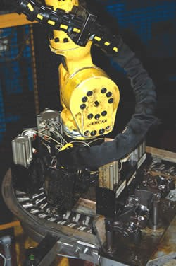 Toploader robot transfers the part to the conveyor