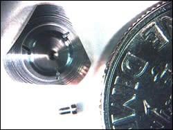 Turbine engine nozzle with a triangular base