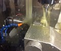 bar-fed machining center features a five-axis milling spindle as well as a nine-position turret.
