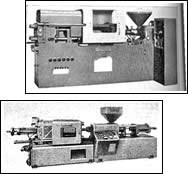 Two of the first reciprocating-screw machines
