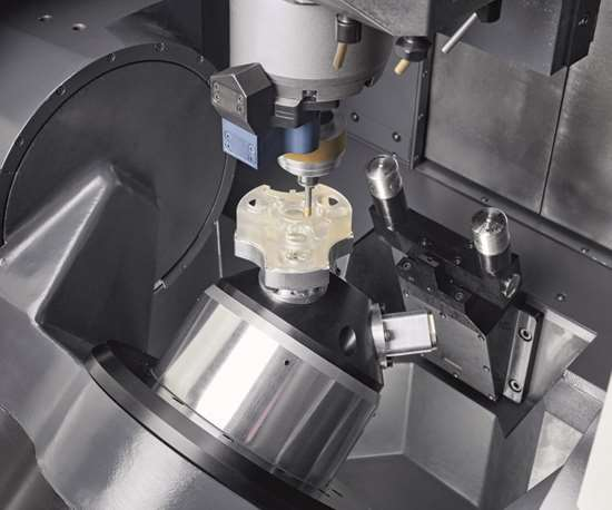 Ultrasonic machining with an abrasive tool