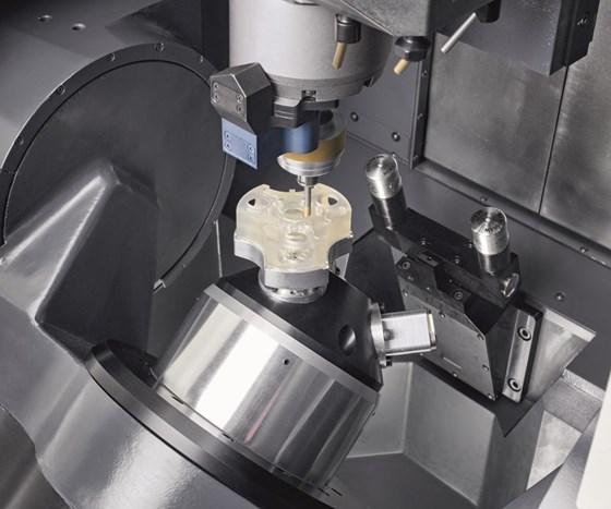 Ultrasonic machining with an abrasive tool