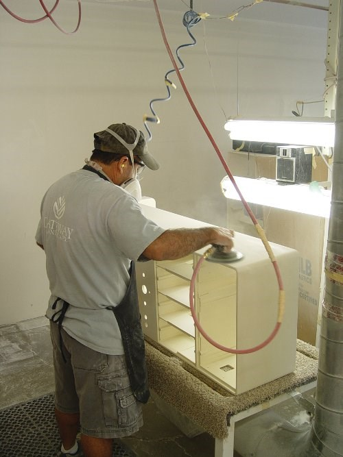 paint spraying on cabinet