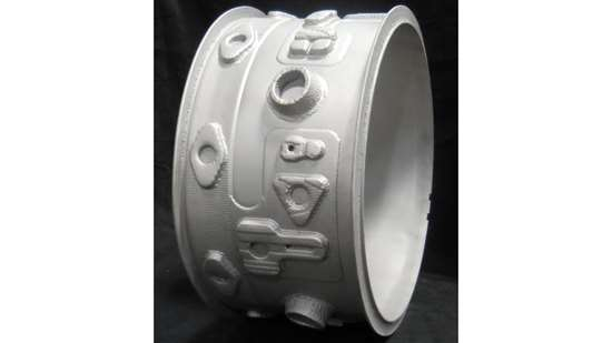 Inconel part consisting of a cylindrical blank and additively manufactured features