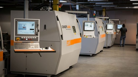 powder-bed additive manufacturing machines