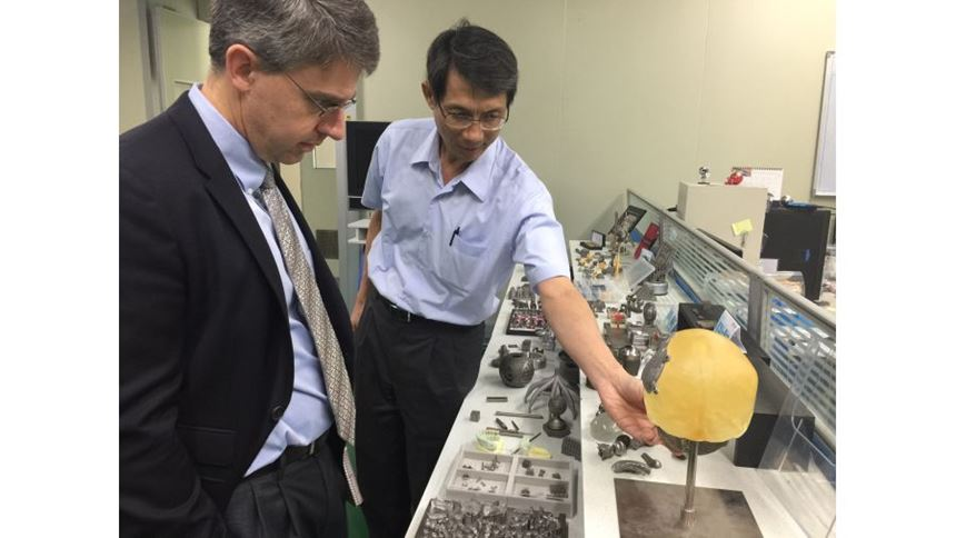 Dr. Horng shows me various parts produced on the powder-bed machine.