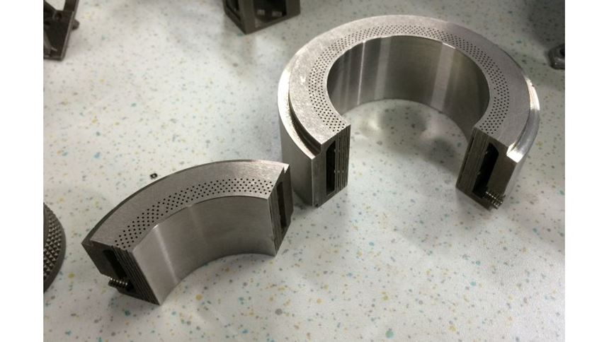 Here is one of those parts. Despite the need for an internal passage for fluid flow, additive manufacturing allows this component to be grown in one piece.