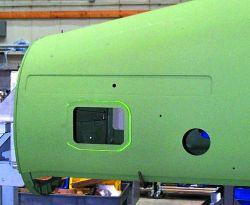 Laser projector identifies out-of-spec design details