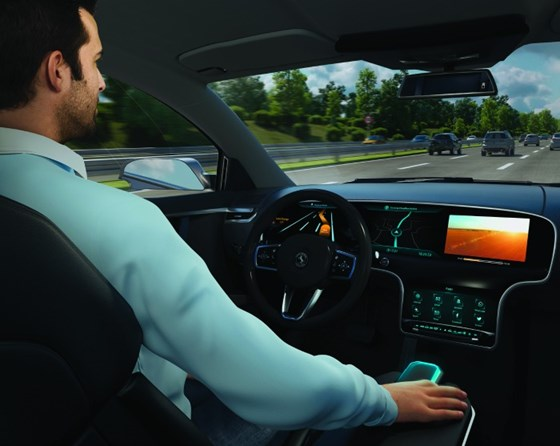 """Given that the move toward autonomous driving is going to evolve, this means that for a period of time a person will be a driver of a vehicle at some point during a journey and a user at another. Haupt cites his daily commute saying that during the first part of his drive and the last part, there is complexity that doesn't yet lend itself to being tackled autonomously, but that the middle section, on the highway, could be handled by a system. To address this, Continental has developed what it calls the """"Smart Control,"""" an input device that would be located in the center console of a vehicle. When manual driving is required, the body of the device would move into the console, leaving only a touchpad on top for use as, say, a controller for the HVAC. When the system determines that automated driving can occur, it indexes out of the console and the driver can activate the autonomous function with the device like a joystick. What's more, the Smart Control provides color coding to indicate to the driver/user and passengers the state of driving conditions. According to Dr. Frank Rabe, head of the Instrumentation & Driver HMI business unit at Continental, """"The success of automated vehicles depends on the user's trust and acceptance. We achieve this with a holistic human-machine interface, which transparently informs users with intuitive interaction concepts and which enables them to control driving maneuvers. With Smart Control, we have developed a new element for the dialogue between user and vehicle."""""""
