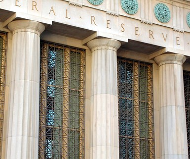 Fed Signals Rate Cut but Warns on Trade Wars