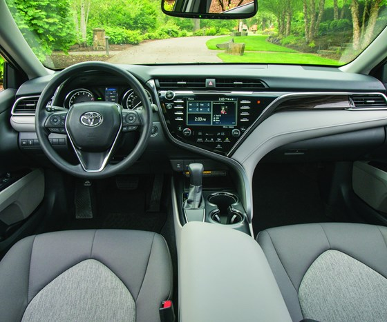 The exterior forms are echoed on the instrument panel. Note how there are sweeping lines that meet in the center of the IP and then travel down to the center console. This, incidentally, is the interior of the LE, the entry trim level.